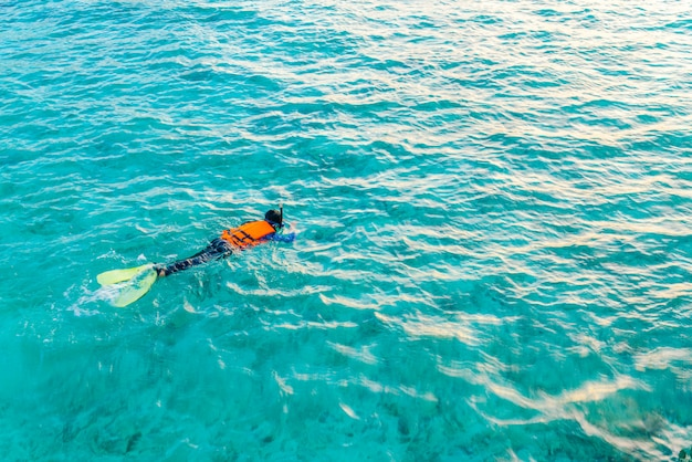 Snorkeling in tropical maldives island .
