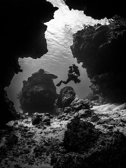 Snorkeling underwater on black and white