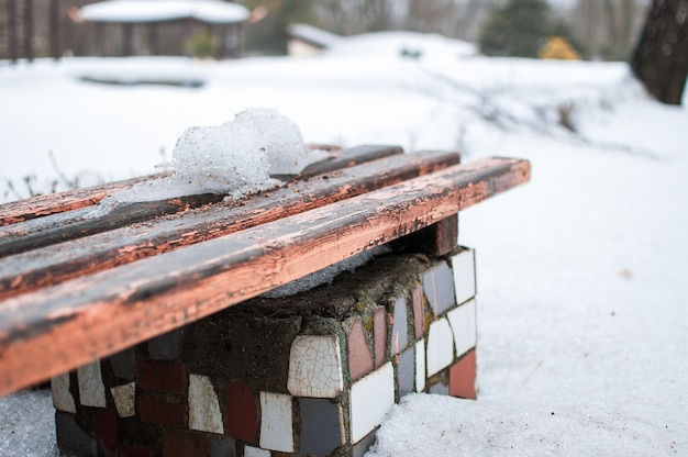 Snow bench in the park.