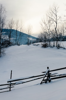 Snow capped fence winter mountain landscape
