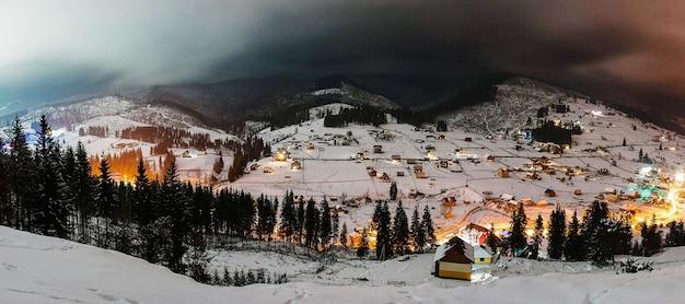 Snow-capped houses in mountains carpathians ukraine