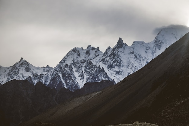 Snow capped massif mountain peaks in karakoram range at sunset
