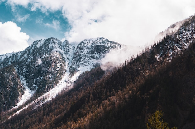 Snow-capped mountain peaks of the altai mountains against the sky
