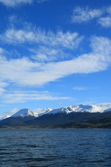 Snow capped mountain range view from the cruise ship on beagle channel, ushuaia, argentina