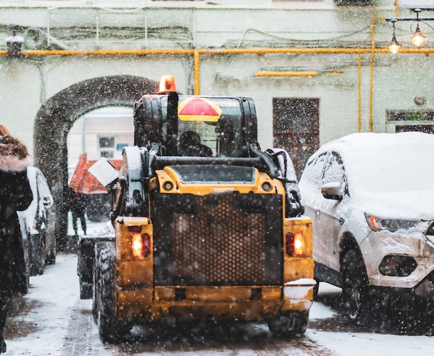 Snow cleaning machine work hard in city streets b