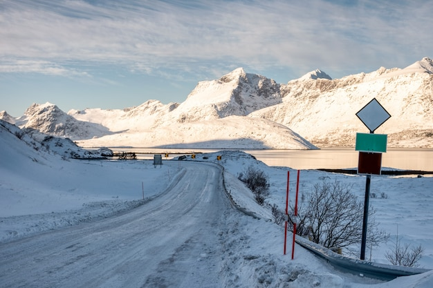 Snow on country road with traffic sign in valley