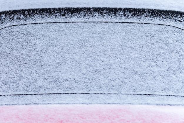Snow covered car window