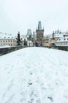 Snow covered charles bridge in prague