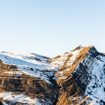 Snow covered mountains peaks, winter mountains