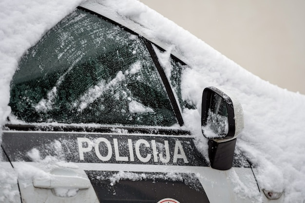 Snow-covered police vehicle in the parking lot, riga, latvia