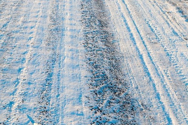 Snow-covered road after the last snowfall. roadway small size which traces the track and the wheels.