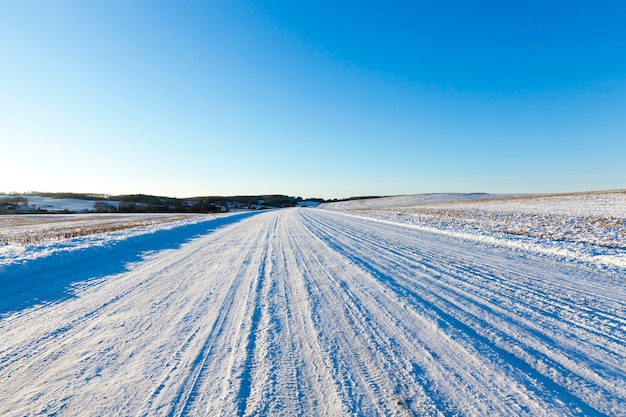 Snow-covered road, on which there were traces of the car to drive
