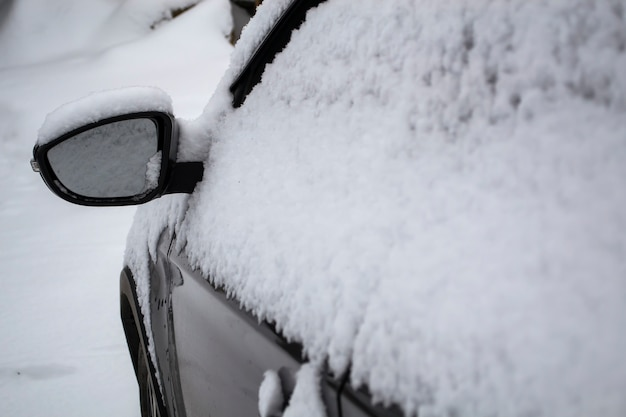 Snow covered side mirror of the car