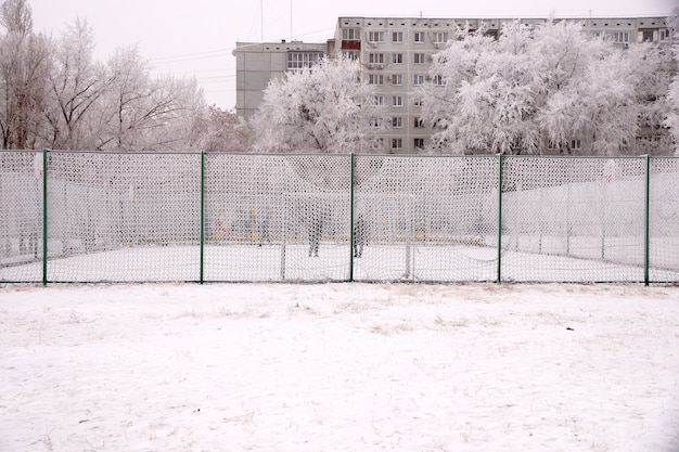 Snow-covered sports ground near the school in volgograd