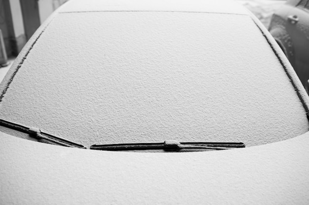 Snow-covered windshield on the car.