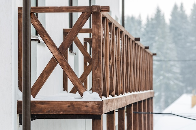 Snow-covered wooden balustrade