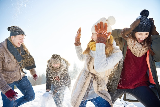 Snow fight between two couples