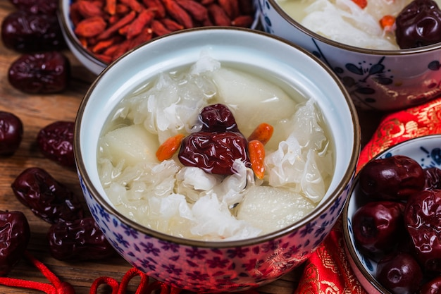 Snow fungus and pear sweet soup dessert chinese healthy Premium Photo