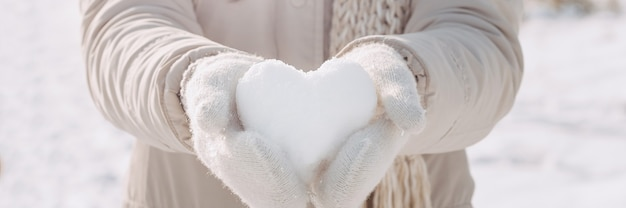 Snow heart in hands