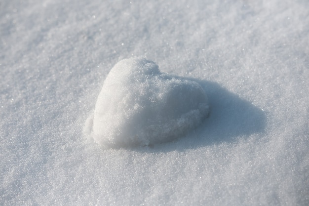 Snow heart on winter snow space