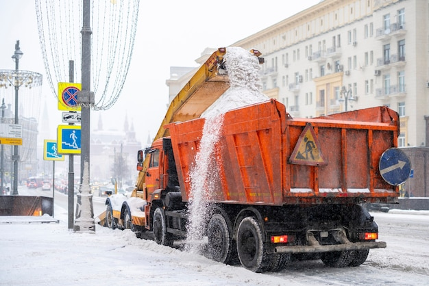 Snow plow removing snow from the road b