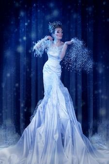 Snow queen in the forest creates a blizzard