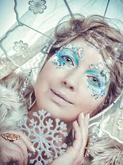 Snow queen over white background.