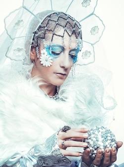 Snow queen over white background Premium Photo