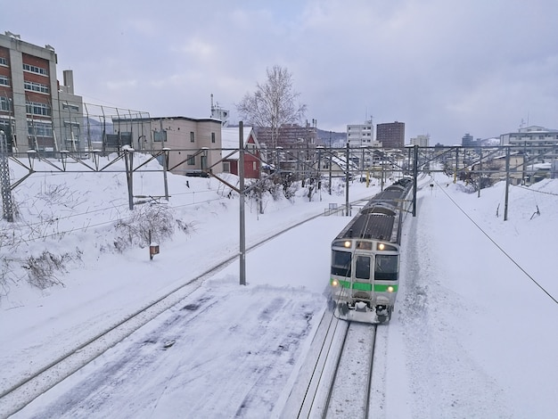 Snow rail track and local train in otaru city hokkaido japan during mid winter