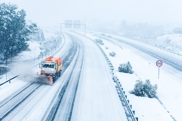 Snow removal machine removing snow from spanish highway