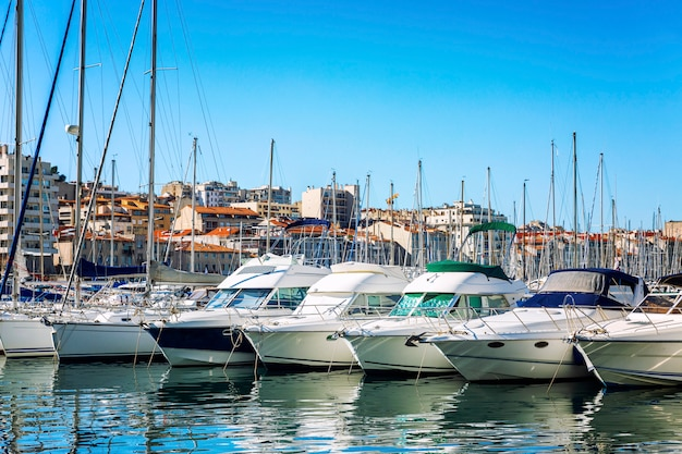 Snow-white sailing yachts in a marina in marseille on a bright sunny day. beautiful view.