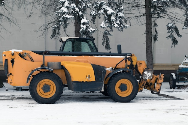 Snowblower in a parking lot, winter snow removal equipment