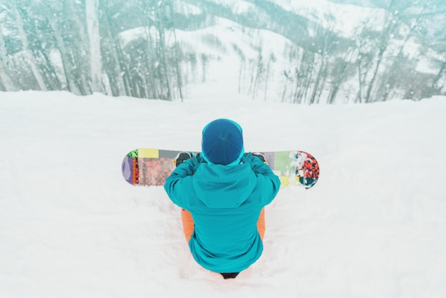Snowboarder looking at slope