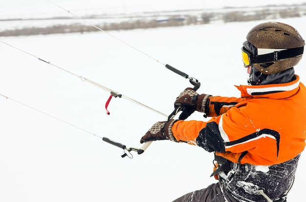 Snowboarder riding a kite