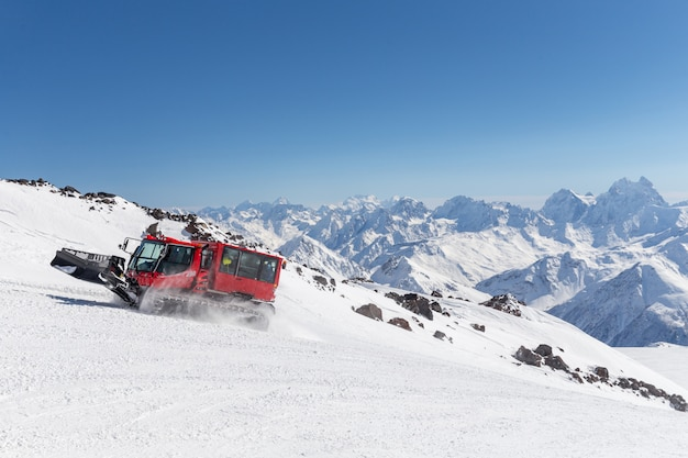 Snowcat on a slope high up in the mountains