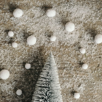 Snowed wood with christmas tree