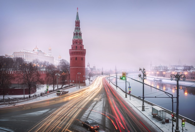 Snowfall over vodovzvodnaya and other towers and temples of the moscow kremlin