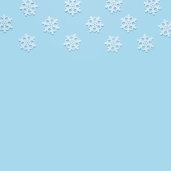 Snowflake on baby blue background with copy space