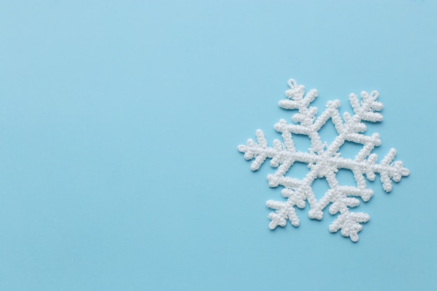 Snowflake on blue surface