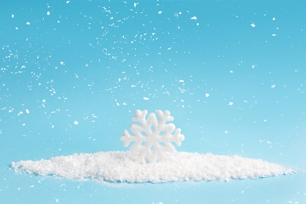 Snowflake and snow on blue background. christmas composition.