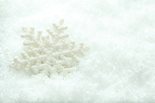 Snowflake in snow on a white background