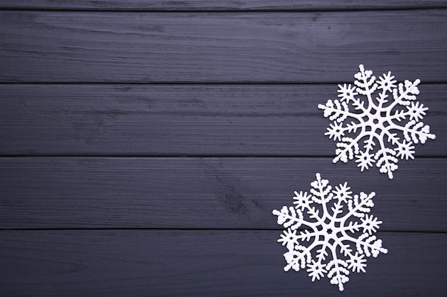 Snowflakes on a black wooden background. christmas concept.