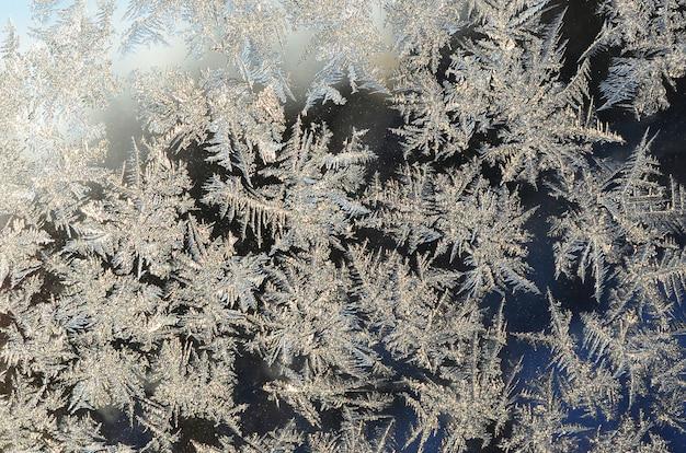 Snowflakes frost rime macro on window glass pane