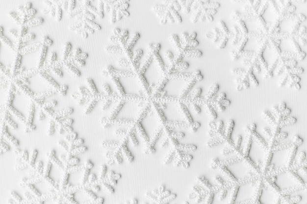 Snowflakes on white surface