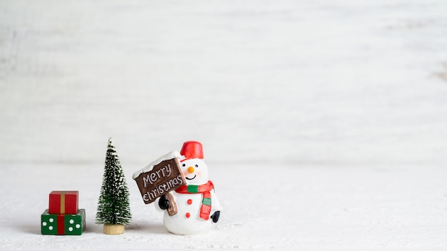 Snowman doll, mini christmas tree and gift boxes
