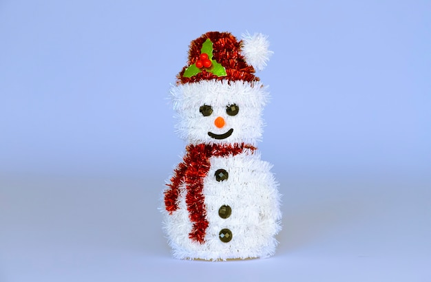 Snowman toy on a ice blue copy space background.