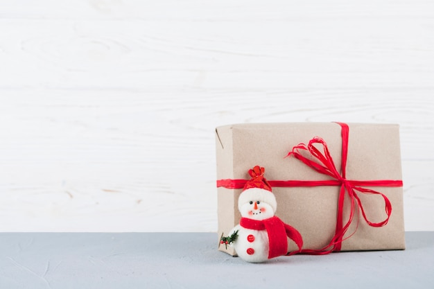 Snowman toy with wrapped christmas gift