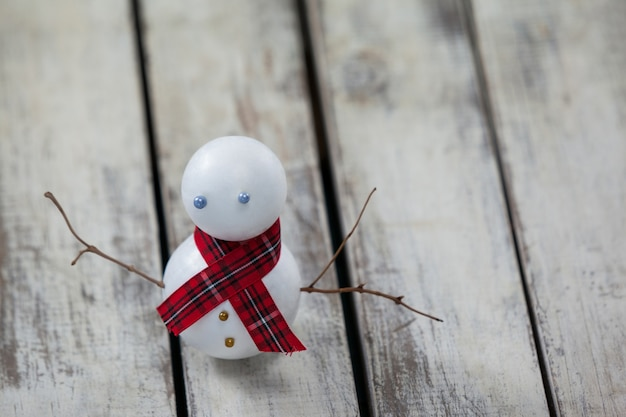 Snowman on a wooden table