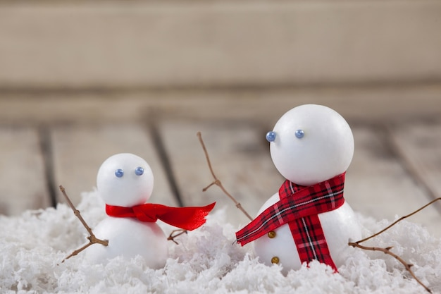 Snowmans on a wooden table