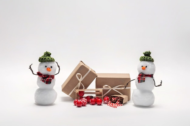Snowmen with christmas gift boxes